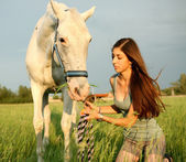 The girl and white horse — Stock Photo