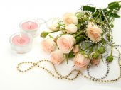 Fine roses and candles — Stock Photo