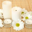 Burning candles and flowers — Stock Photo #57824259