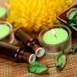 Aromatic oil and candles — Stock Photo #59972509