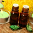 Aromatic oil and candles — Stock Photo #59972535