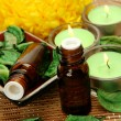 Aromatic oil and candles — Stock Photo #59972541