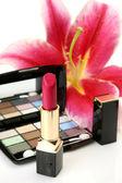 Decorative cosmetics and flower — Stock Photo