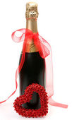 Champagne and red heart — Stockfoto