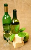 Wine bottles and cheese — Stock Photo