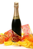 Petals of roses and champagne — Stock Photo