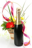 Champagne bottle and flowers — Stock Photo