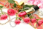 Pink lipstick and roses — Stock Photo