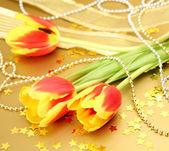 Yellow tulips and beads — Stock Photo