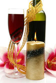 Wine, candle and lily flowers — Stock Photo