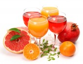 Ripe fruits and juice — Stock Photo