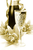 Wine glass and lilies — Stock Photo