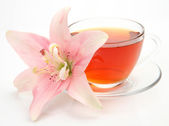 Tea and pink lily — Stock Photo