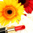 Decorative cosmetics and flowers — Stock Photo #65598835