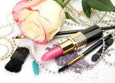 Decorative cosmetics with rose — Stock Photo
