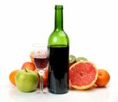 Ripe fruits and red wine — Stock Photo