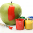 Apple and colorful  paint with a brush — Stock Photo #67819499