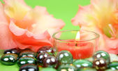 Lily flowers,candles and decorative stones — Stock Photo