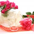 Pink roses flowers and candle — Stock Photo #67822125
