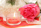 Pink rose flower and candle — Stock Photo