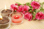 Still-life with  candles  and pink roses — Stock Photo