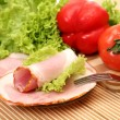 Slices of ham and vegetables — Stock Photo #68086599