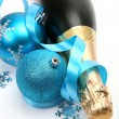 Champagne and blue Christmas toys — Stock Photo #68087593