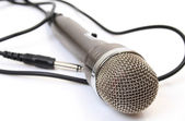Black microphone with wire — Stock Photo