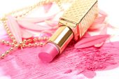 Pink lipstic on smeared traces of cosmetics — Stock Photo