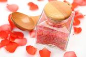 Spoon,sea salt and  roses  petals — Stock Photo