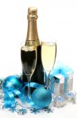 Champagne, gift and new year decorations — Stock Photo