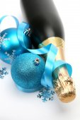 Champagne and blue Christmas toys — Stock Photo