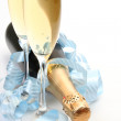 Champagne and blue tape — Stock Photo #70822849