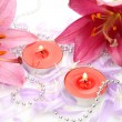 Pink lilies and candles — Stock Photo #70822893