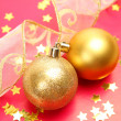 New Year's spheres with confetti  and ribbon — Stock Photo #70823205
