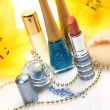 Decorative cosmetics with yellow lily flowers — Stock Photo #70828545