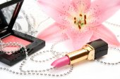 Decorative cosmetics with lily flower — Stock Photo