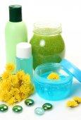 Shampoo,cream and flowers — Stock Photo