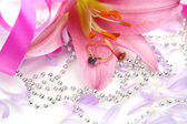 Pink lily and ring — Stock Photo