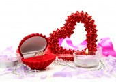Scarlet heart with ring with romantic decorations — Stockfoto