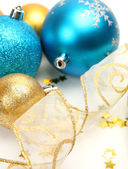 New Year's spheres with confetti  and ribbon — Stock Photo