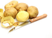 Raw potatoes and knife — Stock Photo