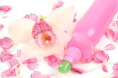 Cosmetic bottle with  orchid and petals — Fotografia Stock