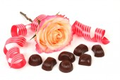 Chocolate candies with  rose and tape — Stock Photo