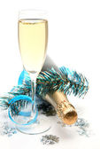 Champagne with New Year decoration — Stock Photo