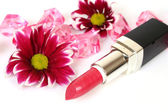 Decorative cosmetic with flowers — Stock Photo