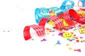 Colorful confetti and streamers — Stock Photo
