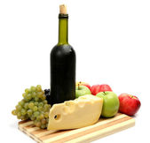 Wine, grapes, apples and cheese — Stock Photo