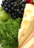 Grapes, apple and cheese — Stock Photo