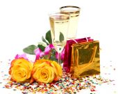 Champagne , yellow roses and gift packages — Stock Photo